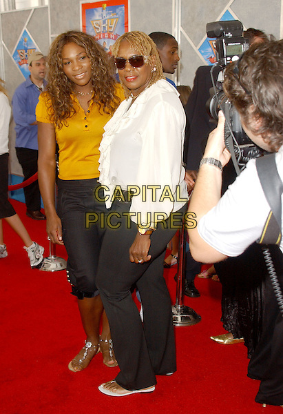 "SERENA WILLIAMS & ORACENE .The Walt Disney Picyures' World Premiere of ""Sky High"" held at The El Capitan Theatre in Hollwyood, California..July 24th, 2005.full length mother daughter family sunglasses shades white jacket yellow shirt black trousers three quarter length cropped.www.capitalpictures.com.sales@capitalpictures.com.Supplied By Capital PIctures"