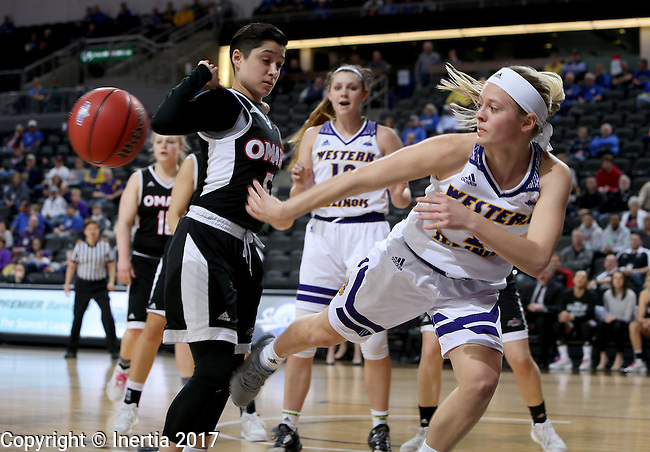 SIOUX FALLS, SD: MARCH 6: Emily Clemens #2 from Western Illinois saves the ball from going out of bounds in front of Amber Vidal #5 from Omaha during the Summit League Basketball Championship on March 6, 2017 at the Denny Sanford Premier Center in Sioux Falls, SD. (Photo by Dave Eggen/Inertia)