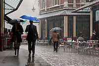 Heavy rain in a London Street  near Covent Garden. London, England, UK May 1st 2008