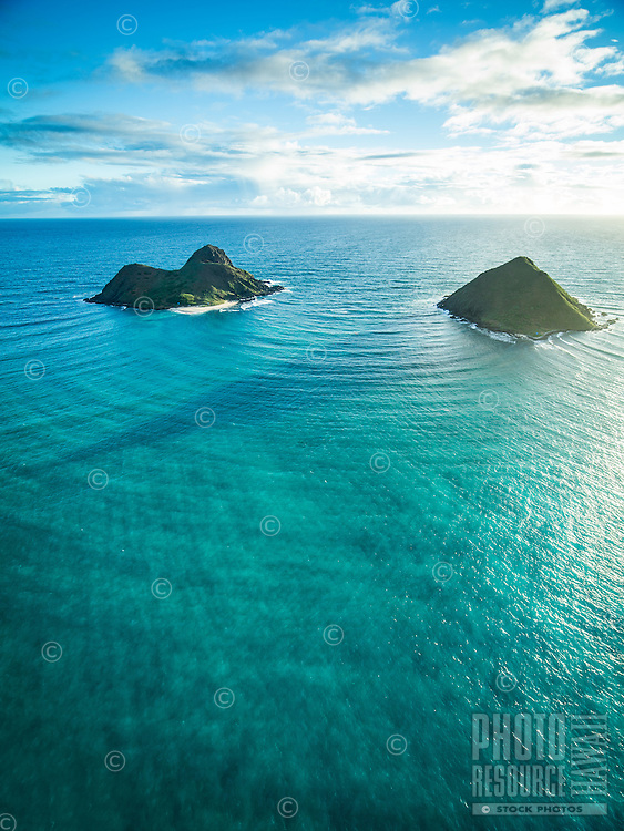 The Mokuluas are islets off of the coast of the Lanikai neighborhood in Kailua, Windward O'ahu.