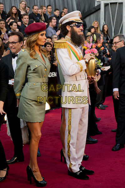 Sacha Baron Cohen as General Aladeen, The Dictator.Arrivals at the 84th Annual Academy Awards® in Hollywood, CA., USA..February 26, 2012.*Editorial Use Only*.oscars full length white costume epaulettes urn gold beard hat green dress sunglasses shades Kim Jong-il .CAP/A.M.P.A.S./NFS.©A.M.P.A.S. Supplied by Capital Pictures.