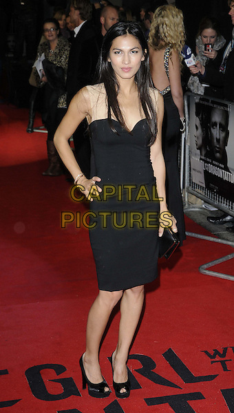 Elodie Yung.'The Girl With The Dragon Tattoo' World film Premiere, Odeon Leicester Square, London, England..12th December 2011.full length black clutch bag peep toe shoes dress hand on hip.CAP/CAN.©Can Nguyen/Capital Pictures.