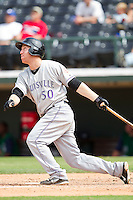 Todd Frazier #50 of the Louisville Bats follows through on his swing against the Charlotte Knights at Knights Stadium on July 17, 2011 in Fort Mill, South Carolina.  The Knights defeated the Bats 7-6.   (Brian Westerholt / Four Seam Images)