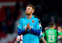 Cian Bolger of Fleetwood Town applauds the traveling Fleetwood Town fans after the Sky Bet League 1 match between Doncaster Rovers and Fleetwood Town at the Keepmoat Stadium, Doncaster, England on 17 February 2018. Photo by Leila Coker / PRiME Media Images.