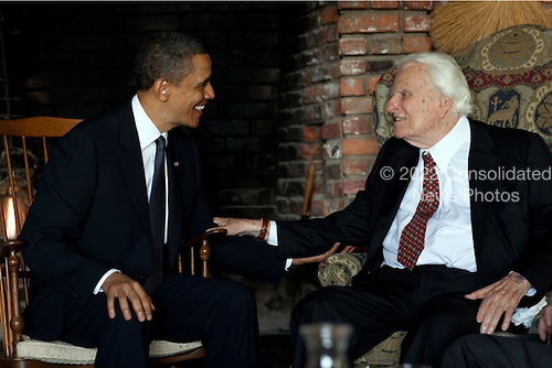 United States President Barack Obama, left, meets the Reverend Billy Billy Graham, right, at his home in North Carolina.  The President had a private prayer and conversation with Reverend Graham. Franklin Graham (not pictured) was also in attendence.Mandatory Credit: Pete Souza - White House via CNP