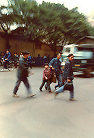 People crossing busy street in Canton.Pictures taken in Canton China in 1977 at the time of the cultural revolution.