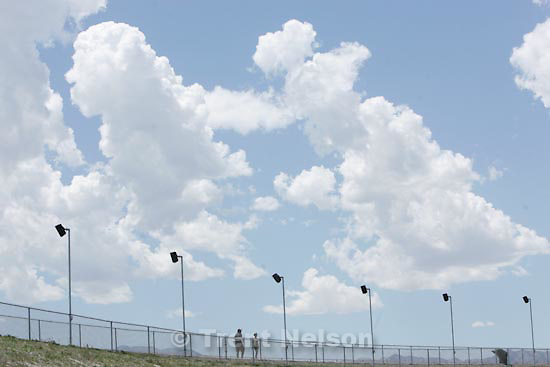 Photo by Trent Nelson  |  The Salt Lake Tribune..A pair of fans walk along the outside of the track during the qualifying round for the Larry H. Miller Dealerships Utah Grand Prix, American Le Mans Series at Miller Motorsports Park in Tooele, Saturday, July 10, 2010.