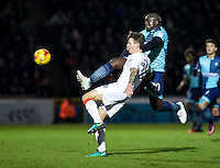 Adebayo Akinfenwa of Wycombe Wanderers and Glen Rea of Luton Town during the Sky Bet League 2 match between Wycombe Wanderers and Luton Town at Adams Park, High Wycombe, England on the 21st January 2017. Photo by Liam McAvoy.