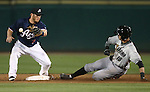 Omaha Storm Chasers' Paulo Orlando slides in safely under the tag of Reno Aces' Garrett Weber during the first game of the PCL championship series in Reno, Nev., on Monday, Sept. 8, 2014. <br /> Photo by Cathleen Allison