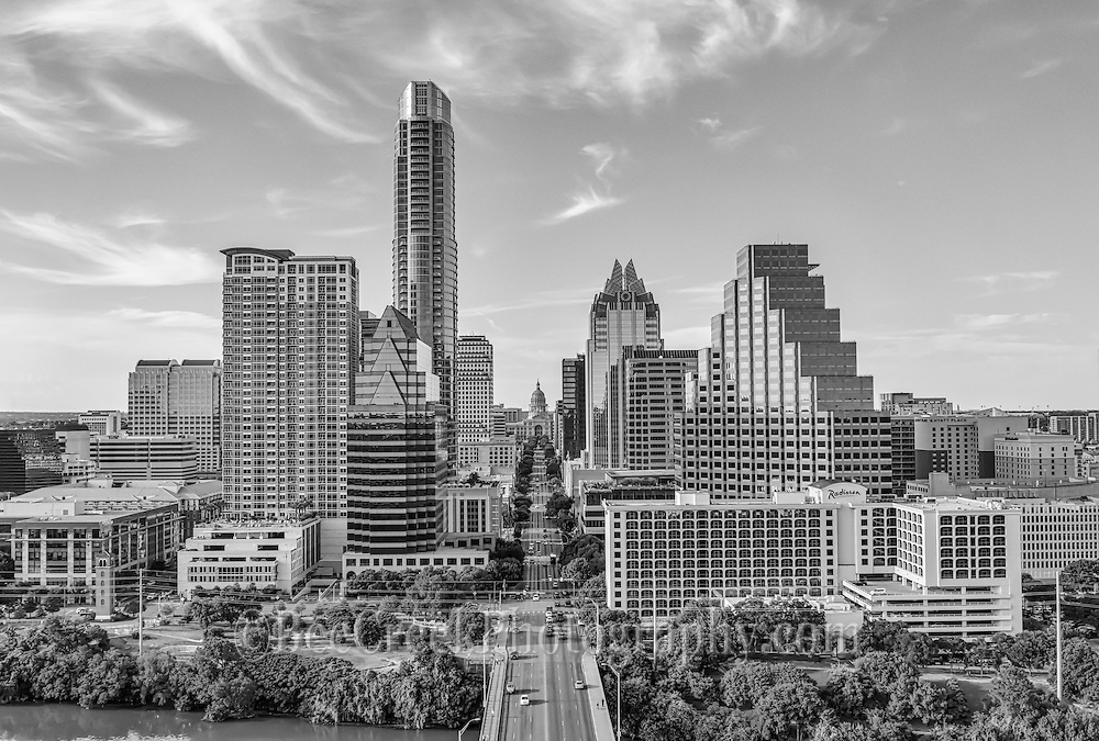 We captured this aerial black and white image of the City of Austin skyline looking straight down Congress Ave.  In this cityscape you can see the Texas Capitol along with mamy of the city high-rise buildings including the Frost, Austonian, One Congress Plaza, Radisson Hotel, Marriott, Ashton Condos, and One Congress.  Also in the photo are a bit of Lady Bird Lake.