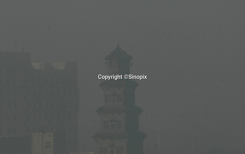 The pagoda of Linfen City is shrouded in pollution at 11 am on a sunny day, Shanxi Province, China. Linfen is reportedly the most polluted city in China and at the heart of the coal mining industry. China produces around 2.4 billion tones of coal annually that contributes to more than 400,000 premature deaths annually due to air pollution, acid rain and poisonous ground water. It also contributes to global warming...PHOTO BY SINOPIX