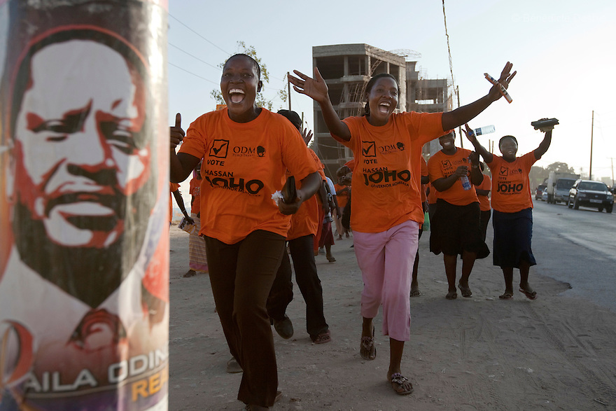 28 february 2013 - Mombasa, Kenya - Supporters of Orange Democratic Movement (ODM) Kenyan Presidential candidate Raila Odinga walks in the streets of Mombasa, Kenya. General elections will be held in Kenya on 4 March 2013. They will be the first elections held under Kenya's new constitution, promulgated in 2010. The last Kenya's elections left more than 1000 people dead and 650,000 displaced. Presidential candidate Uhuru Kenyatta is facing charges of crimes against humanity at the International Criminal Court (ICC) for his role in inciting the 2007-2008 post-election violence. Photo credit: Benedicte Desrus