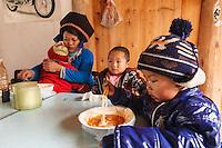 Asia,Cina,Danzhai,Ya Hui, family at restaurant ,China minority