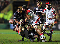 Jamie Gibson is tackled in possession. Heineken Cup match, between Leicester Tigers and Ulster Rugby on January 18, 2014 at Welford Road in Leicester, England. Photo by: Patrick Khachfe / JMP