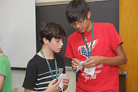 OrigamiUSA 2016 Convention at St. John's University, Queens, New York, USA. Creasers in Robert Lang's class on his design Classical Cicada. Conner Beavers (r), North Carolina helps first timer Joseph Sime, New Zealand with a fold.