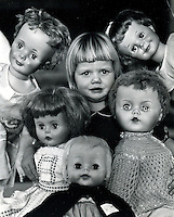 DOLL FACE, live girl in the middle of a group of dolls is 4 yr-old Gennifer Lambert of Concord, Ca. She is posing with this array of dolls exhibited by Concord Recreation Dept.1964 (photo by Ron Riesterer).