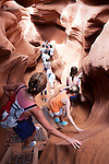 Tourists descend into Lower Antelope Canyon, a slot canyon in Page, Arizona, AZ, USA