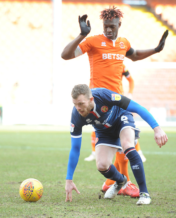 Walsall's Nicky Devlin under pressure from Blackpool's Armand Gnanduillet<br /> <br /> Photographer Kevin Barnes/CameraSport<br /> <br /> The EFL Sky Bet League One - Blackpool v Walsall - Saturday 9th February 2019 - Bloomfield Road - Blackpool<br /> <br /> World Copyright &copy; 2019 CameraSport. All rights reserved. 43 Linden Ave. Countesthorpe. Leicester. England. LE8 5PG - Tel: +44 (0) 116 277 4147 - admin@camerasport.com - www.camerasport.com