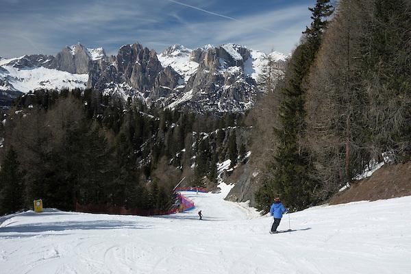 Woman skiing at Ciampac Ski Area, Dolomites, Canazei, Italy,