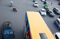 Cars, buses, taxis, motorcycles and scooters, are seen at a busy intersection in Xian, Shaanxi, China.