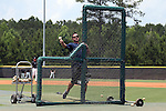 04 June 2016: Nova Southeastern head coach Greg Brown throws batting practice on Field 4 before the game. The Nova Southeastern University Sharks played the Millersville University Marauders in Game 14 of the 2016 NCAA Division II College World Series  at Coleman Field at the USA Baseball National Training Complex in Cary, North Carolina. Nova Southeastern won the game 8-6 and clinched the NCAA Division II Baseball Championship.