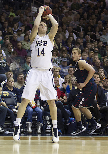 January 12, 2013:  Notre Dame guard Scott Martin (14) goes up for a shot during NCAA Basketball game action between the Notre Dame Fighting Irish and the Connecticut Huskies at Purcell Pavilion at the Joyce Center in South Bend, Indiana.  Connecticut defeated Notre Dame 65-58.