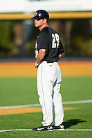 Wake Forest Demon Deacons coach Grant Achilles #29 coaches first base during the Atlantic Coast Conference game against the Miami Hurricanes at Gene Hooks Field on March 19, 2011 in Winston-Salem, North Carolina.  Photo by Brian Westerholt / Four Seam Images