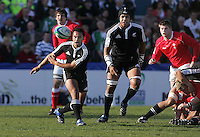 New Zealand scrum half Wayne Ngaluafe gets his backline moving during the Division A clash against Wales at Ravenhill. Result New Zealand 37 Wales 14.