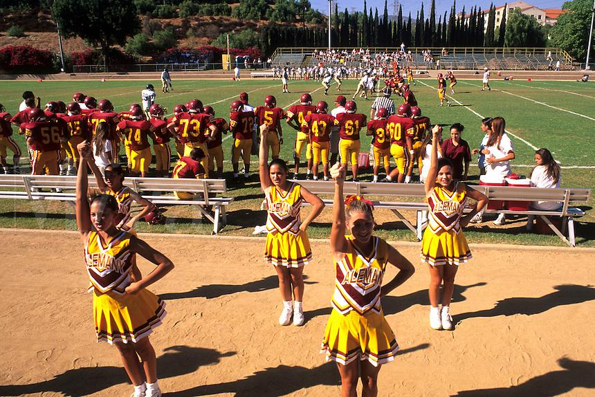 Cheerleaders leading cheer for high school football game in Los Angeles Californi