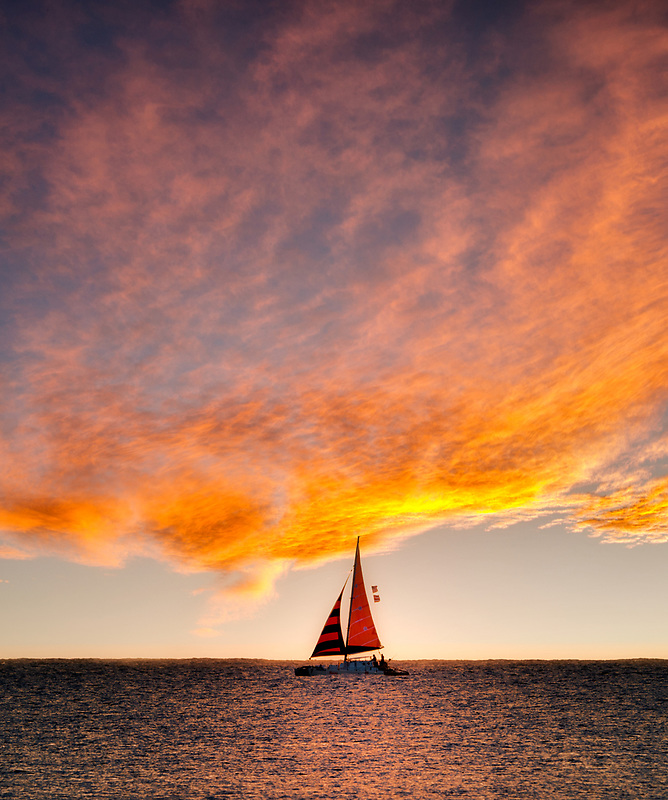 Sailboat at sunset. Kauai, Hawaii