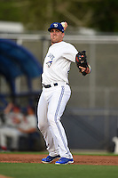 Dunedin Blue Jays third baseman Mitch Nay (28) warmup throw to first during a game against the Brevard County Manatees on April 23, 2015 at Florida Auto Exchange Stadium in Dunedin, Florida.  Brevard County defeated Dunedin 10-6.  (Mike Janes/Four Seam Images)