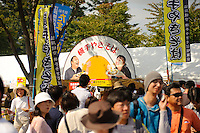 "Visitors to the B1 Grand Prix, Yokote, Akita Pref, Japan, September 20 2009. The B1 Grand Prix is a competition for inexpensive and tasty regional dishes from around Japan. The B stands for ""b-class gourmet"". In 2009 it was held in the northern Japan city of Yokote."