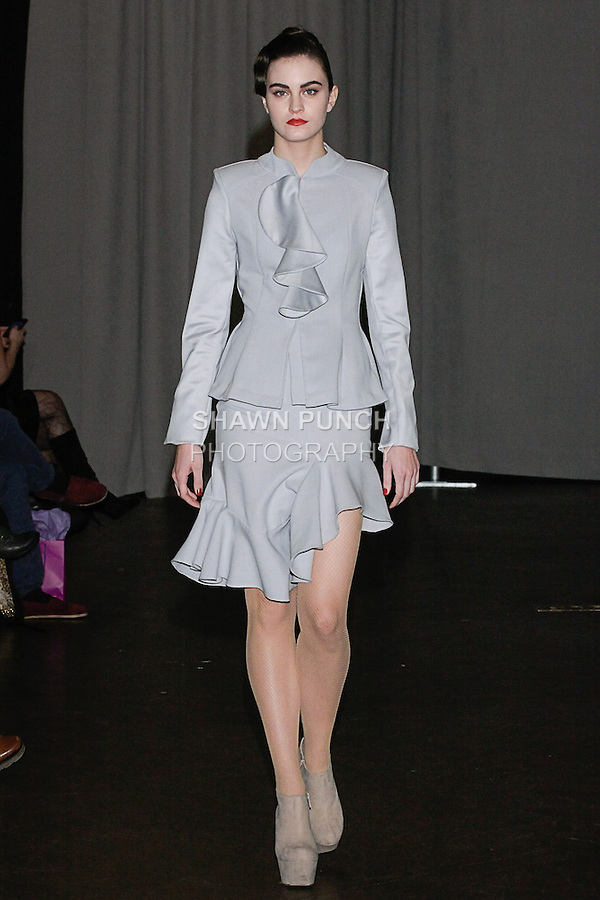 Model walks runway in an outfit from the Yuna Yang Fall Winter 2013 Che Bella collection fashion show at The Desmond Tutu Center in the General Theological Seminary of the Episcopal Church, during New York Fashion Week Fall 2013 February 8, 2013.