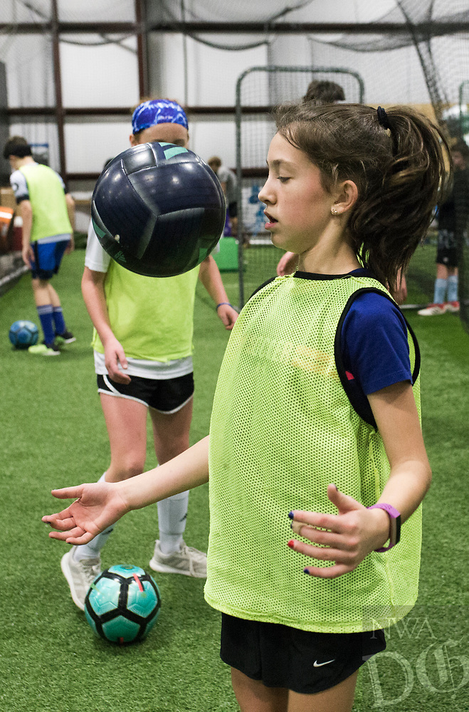 NWA Democrat-Gazette/CHARLIE KAIJO Reagan Crusinbery, 10, of Centerton practices juggling skills during a three-day New Year's Soccer Camp, January 4, 2019 at Strike Zone Training Academy in Rogers. <br /><br />The Specialized Soccer Academy hosted a three-day soccer camp to help build confidence in young athletes.<br /><br />&quot;If they build confidence in a sport they feel like they have something that&acirc;&euro;&trade;s theirs,&quot; said Coach Sarita Saavedra. &quot;They help themselves get better and that translates to confidence in the classroom or anything.&quot;<br /><br />The kids worked on juggling skills, one-versus-one practice and scrimmages.