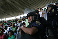 Mexican police officers in riot gear separate the USA and Mexico fans  at Azteca stadium. The United States Men's National Team played Mexico in a CONCACAF World Cup Qualifier match at Azteca Stadium in, Mexico City, Mexico on Wednesday, August 12, 2009.
