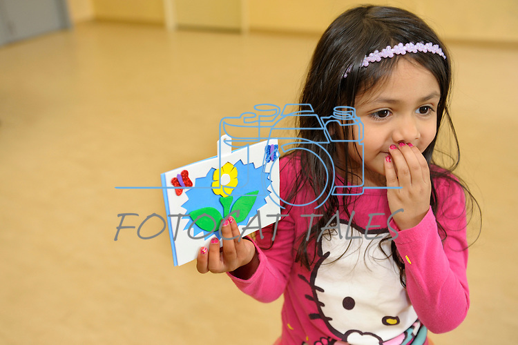 Avani Martinez, 4, of Sparks, shows off her artwork done during Nevada Wildflower Family Fun Day at the Nevada State Museum in Carson City Saturday April 11, 2015. Visitors to the museum were treated to loads of information, hands-on experiences and crafts.<br /> Photo by Lisa J. Tolda