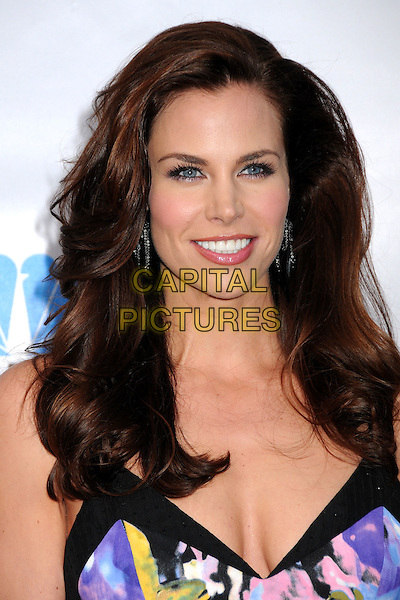 "BROOKE BURNS.The Cable Show 2010 ""An Evening with NBC Universal"" held at Universal Studios Hollywood, Universal City, California, USA..May 12th, 2010.headshot portrait cleavage purple print smiling blue cut out yellow white black.CAP/ADM/BP.©Byron Purvis/AdMedia/Capital Pictures."