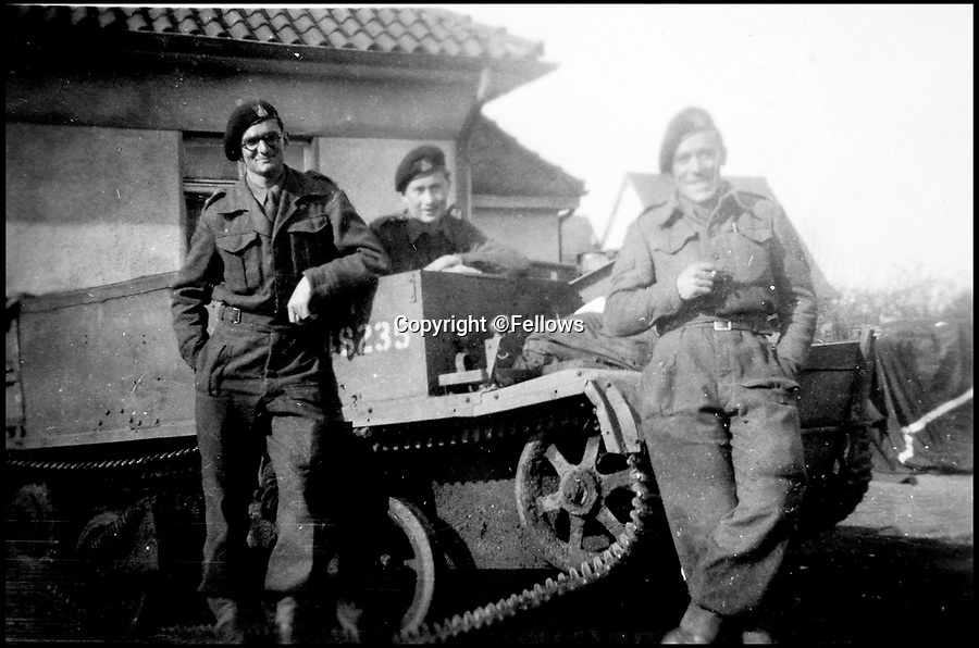 BNPS.co.uk (01202 558833)<br /> Pic: Fellows/BNPS<br /> <br /> Sgt George Rowson(r) during the war.<br /> <br /> Resurfacing - Historic watch captured from a brave German frogman, for whom the road bridge at Nijmegen proved a bridge to far.<br /> <br /> The family of a British WW2 hero who captured a German diver trying to blow up a vital bridge in the wake of Operation Market Garden, are now <br /> selling the incredibly rare Rolex Panerai watch seized from the exhausted diver.<br /> <br /> Sergeant Major George Rowson helped thwart the attempt to destroy the recently captured road bridge at Nijmegen after another team of German frogman had managed to destroy the neighbouring rail bridge.<br /> <br /> The highly trained German special forces placed fixed charges to the underwater footings of both bridge's, but after being spotted, under heavy fire, and in an exhausted state they were captured at gunpoint by Sgt Rowson and his colleagues. <br /> <br /> Sgt Rowson relieved the frogman of his precious watch and wetsuit and kept them until his recent death.<br /> <br /> His family are now selling the historic artefacts with specialist Auctioneers Fellows in Birmingham, with a whopping £40,000 estimate.
