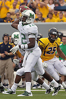 Marshall quarterback Rakeem Cato. The WVU Mountaineers beat the Marshall Thundering Herd 34-13 in a game called just after the fourth quarter started because of severe thunderstorms in the area. The game was played at Milan Puskar Stadium in Morgantown, West Virginia on September 4, 2011.