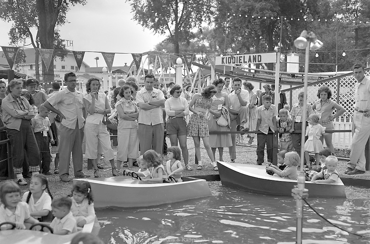 AFL-CIO Union outing at Chippewa Lake amusement park. 1953 Parts watch children on boat ride.