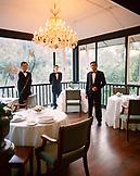 SINGAPORE, waiters standing inside Au Jardin Les Amin Restaurant