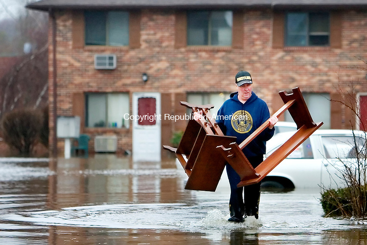 WATERBURY, CT. 16 April 2007-041607SV04--Curt Grell of Waterbury tries to save some expensive furniture from his flooded apartment on Sharon Road in Waterbury Monday. Water from an intense storm flooded the road and apartments.<br /> Steven Valenti Republican-American