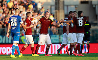 "Calcio, Serie A: Empoli vs Roma. Empoli, stadio ""Carlo Castellani"" 13 settembre 2014.<br /> Roma midfielder Radja Nainggolan, of Belgium, third from left, celebrates with teammates as Empoli defender Lorenzo Tonelli, left, reacts after Empoli goakeeper Luigi Sepe scored an own goal during the Italian Serie A football match between Empoli and AS Roma at Empoli's ""Carlo Castellani"" stadium, 13 September 2014.<br /> UPDATE IMAGES PRESS/Isabella Bonotto"