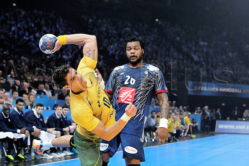 11.01.2017. Accor Arena, Paris, France. 25th World Handball Championships France versus Brazil. Jose Guilherme Toledo Brazil and Cedric Sorhaindo France in action