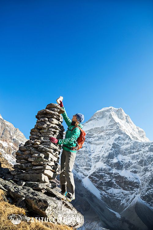 Placing the last stone on a huge cairn in the Nepal Himalaya.