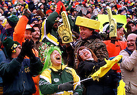 "Green Bay Packers fans celebrate a touchdown during the NFC Divisional Playoff Game against the 49ers on January 4, 1997. Dubbed the ""Mud Bowl"", the Packers emerged the victor 35-14."