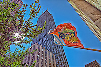 The proud Blackhawks flag flies in the foreground will looking up at Chicago's John Hancock Tower.