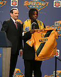 16 January 2004: Joseph Ngwenya (right) of Zimbabwe and Coastal Carolina University, with MLS Commissioner Don Garber (left), was selected with the third pick of the draft by the Los Angeles Galaxy. The Major League Soccer SuperDraft was held at the Charlotte Convention Center in Charlotte, NC as part of the annual National Soccer Coaches Association of America convention...