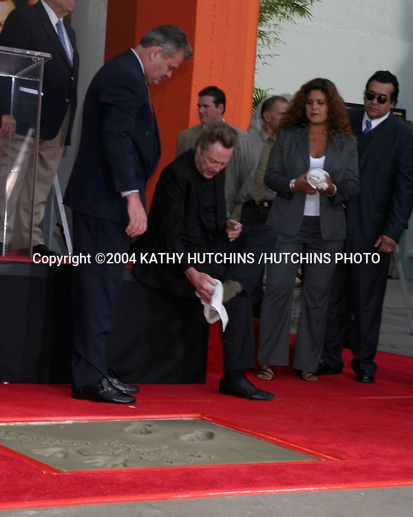©2004 KATHY HUTCHINS /HUTCHINS PHOTO.CHRISTOPHER WALKEN PUTS HIS HANDPRINTS AND FOOTPRINTS IN THE CEMENT AT GRAUMAN'S CHINESE THEATER IN HOLLYWOOD.Los Angeles, CA.OCTOBER 8, 2004..CHRISTOPHER WALKEN