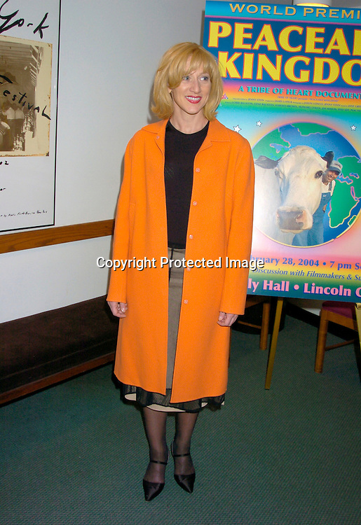 "Edie Falco in Tahari coat and Donna Karan skirt..at the World Premiere of "" Peaceable Kingdom""  on February 29, 2004 at Alice Tully Hall at LIncoln Center in ..New York City. Photo by Robin Platzer, Twin Images"